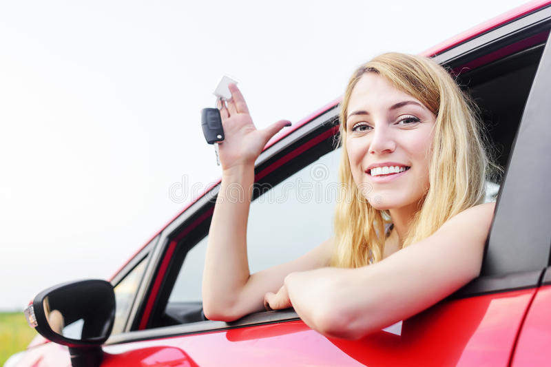 Woman showing keys. royalty free stock photo