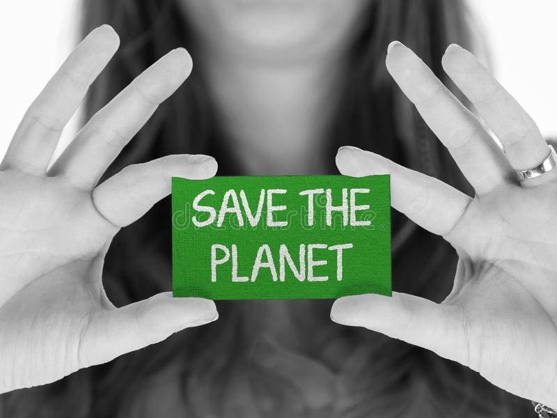 Woman showing a message: Save the planet. Woman showing a small message: Save the planet stock image