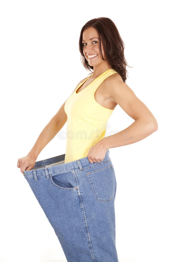 Woman Showing Off Weight Loss Royalty Free Stock Images