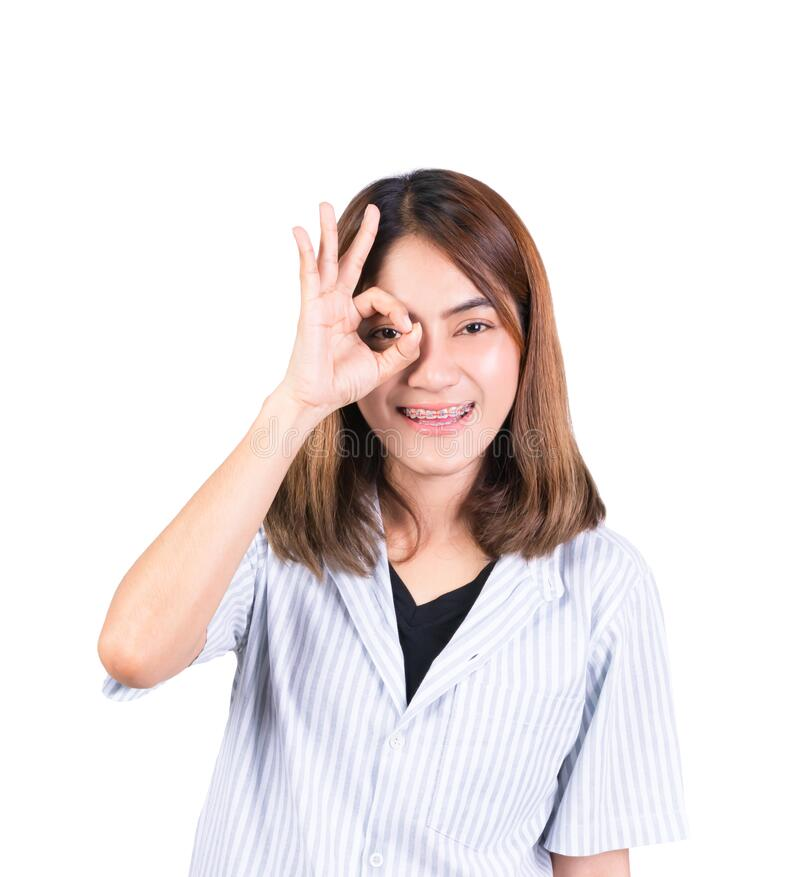 Woman showing OK hand sign over eye on white background.  stock image