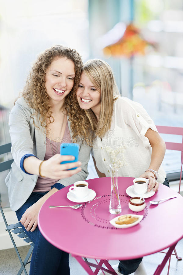Download Woman Showing Phone To Friend Stock Photo - Image: 23506606
