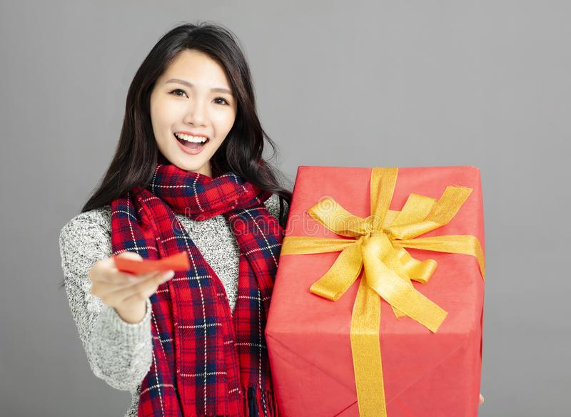 Woman showing red envelopes and gift for chinese new year. Asian woman showing red envelopes and gift for chinese new year stock photo