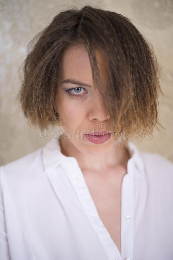 A woman showing a serious stern look stock photo