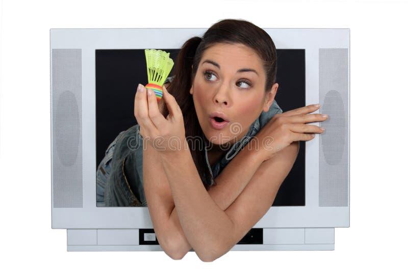 Woman showing a shuttlecock stock photo
