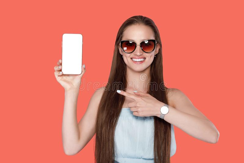 Woman showing on smartphone screen stock photo