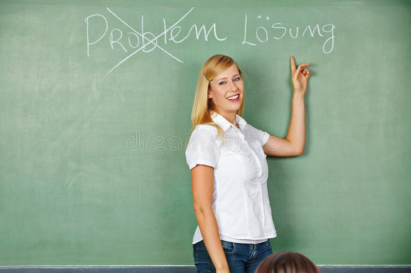 Woman showing solution for problem royalty free stock photo