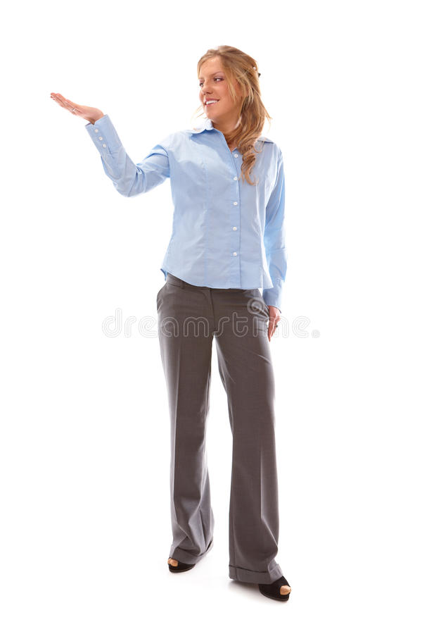 Woman showing something on the palm of her hand stock images