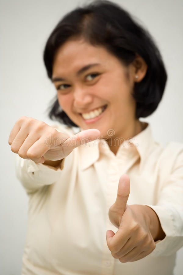 Woman showing two thumbs up royalty free stock photography