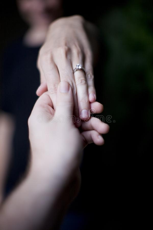 Woman showing wedding ring stock images