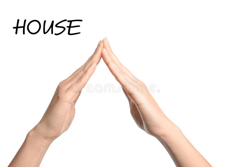 Woman showing word House on white background, closeup. Sign language stock photography