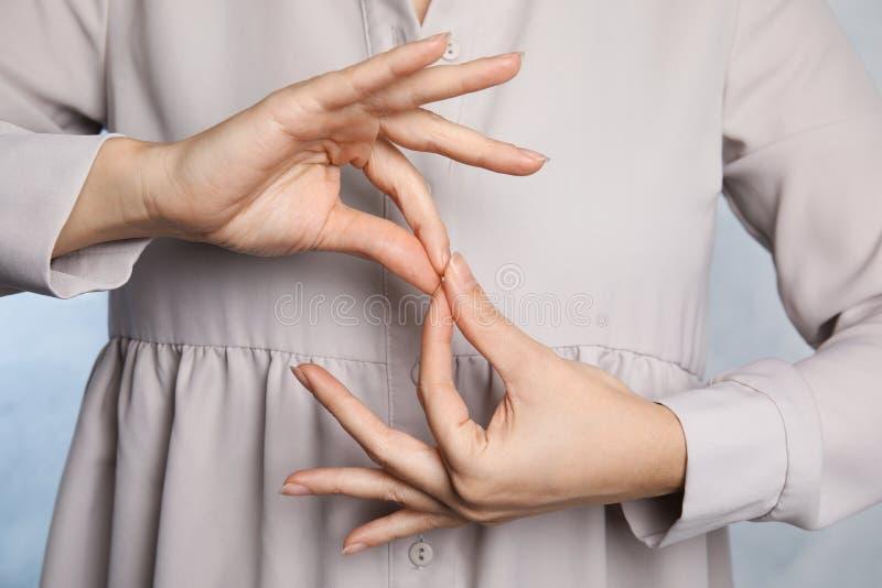 Woman showing word interpreter, closeup. Sign language royalty free stock images