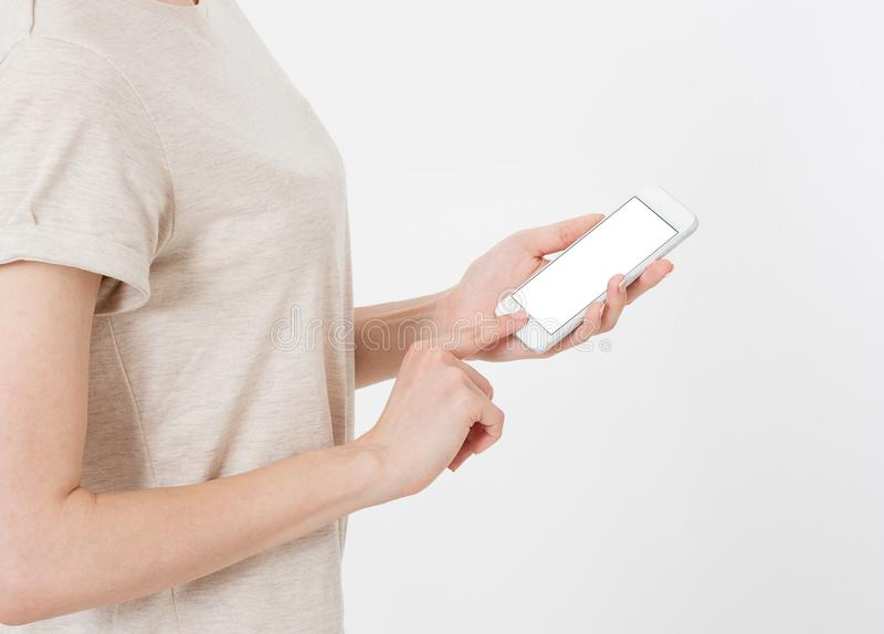 Woman shows blank display of mobile phone, hand points to device, blank screen cellular royalty free stock image