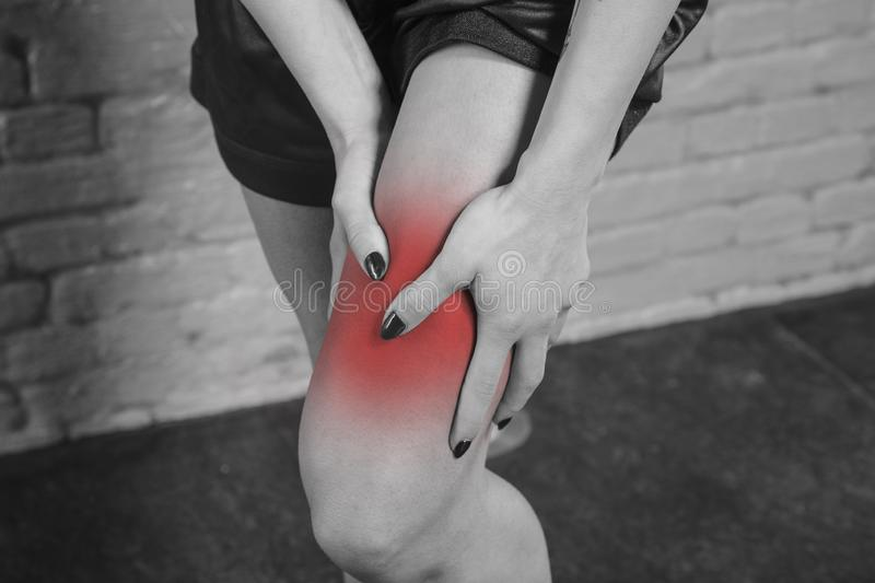 Woman shows that her calf hurts royalty free stock image