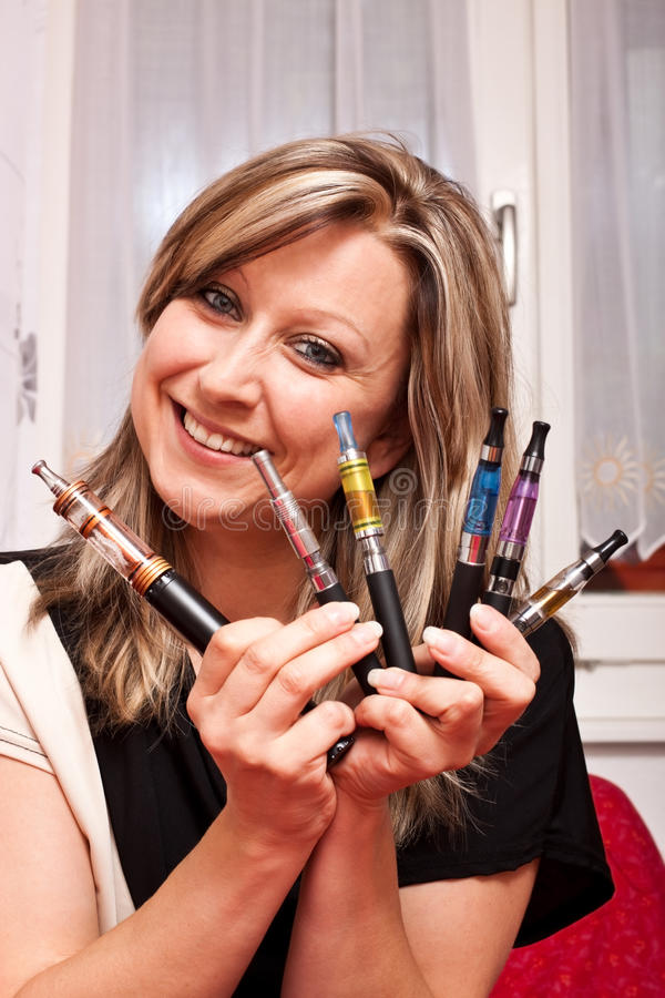 Download Woman Shows Her Collection Electric Cigarettes Stock Image - Image: 25789623
