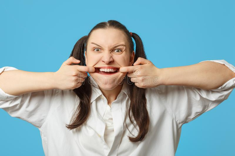 Woman shows her teeth royalty free stock photos