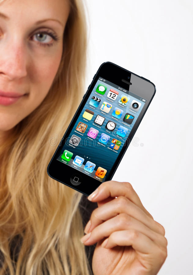 Download Woman shows iphone 5 editorial photo. Image of copy, woman - 26588366