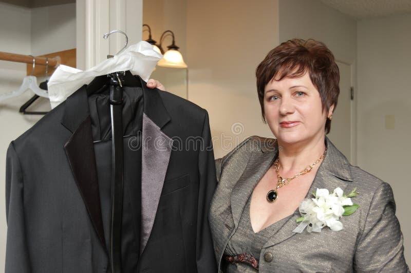 Woman shows tuxedo royalty free stock image