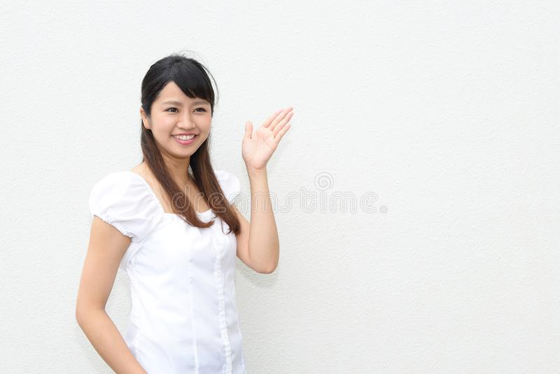 Woman shows the way. Portrait of an Asian woman royalty free stock photo