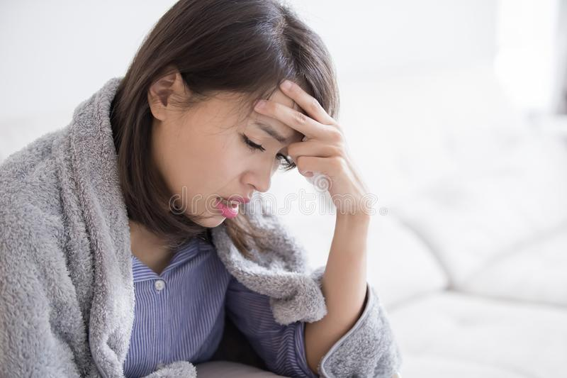 Woman sick and feel headache royalty free stock image