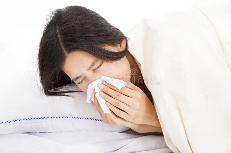 Woman with sick and laying in bed stock photo