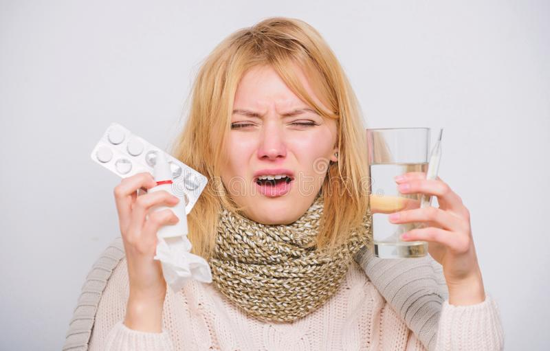 Woman sick person hold glass water and tablets blister. Take pills relieve fever. Drink plenty of fluids. Girl take. Medicine to break fever. Breaking fever stock photos