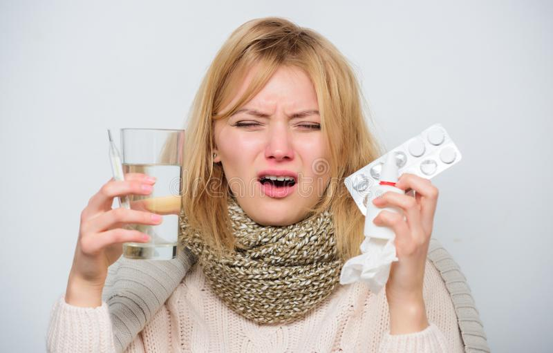 Woman sick person hold glass water and tablets blister. Take pills relieve fever. Drink plenty of fluids. Girl take. Medicine to break fever. Breaking fever stock images