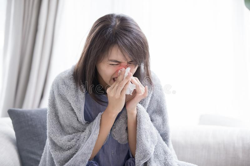 Woman sick and sneeze stock photography