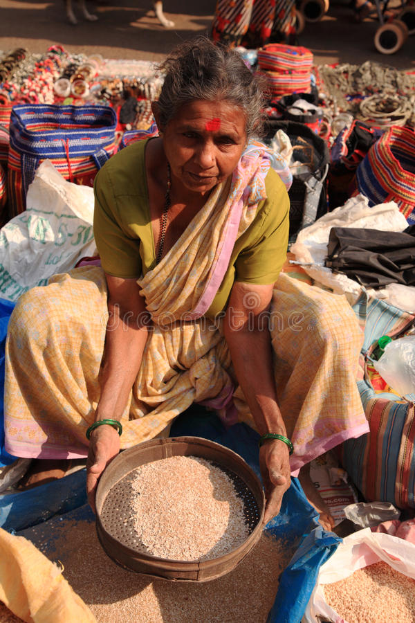 Woman sifting in a street market India stock photography