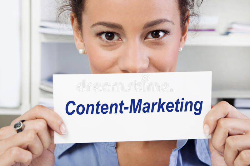Woman with sign of content marketing in her hands royalty free stock image