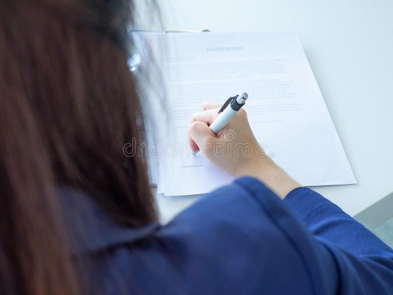 Woman sign contract royalty free stock image