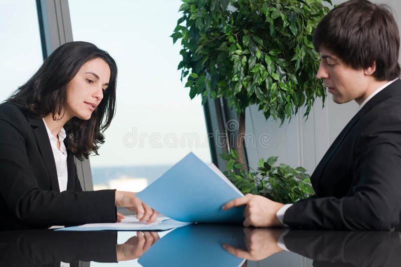 Woman signing documents royalty free stock photography