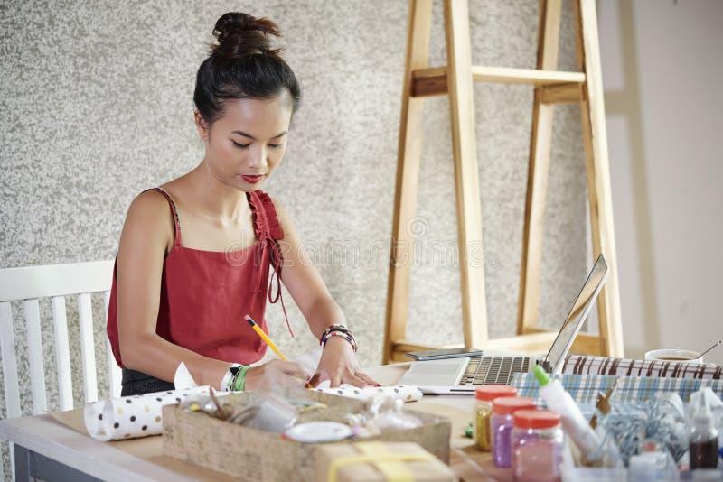 Woman signing handmade present stock photography