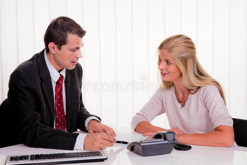 Download Woman Signs A Contract In An Office Royalty Free Stock Photography - Image: 18724117
