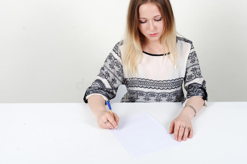 Woman signs documents on white background. stock images