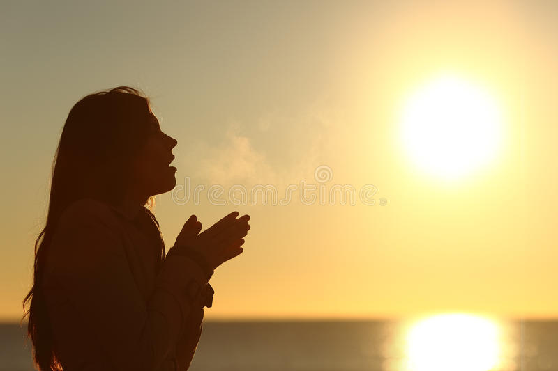 Woman silhouette breathing in a cold winter stock images