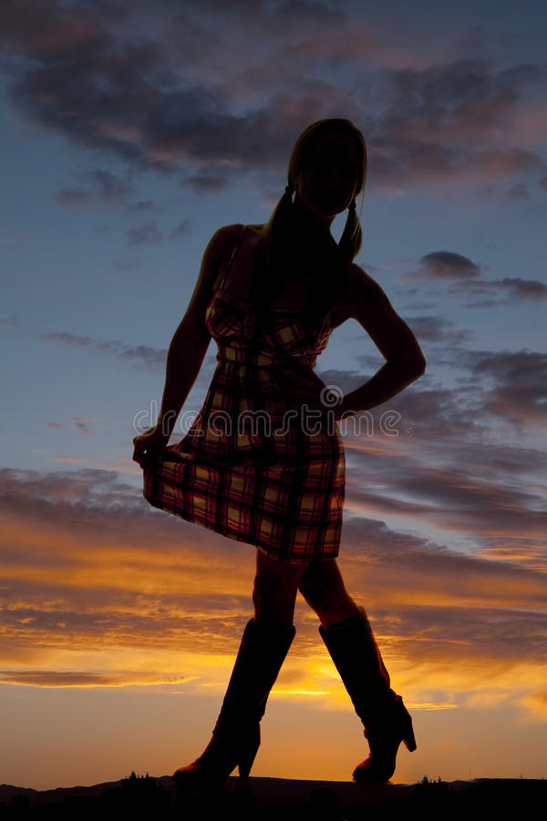 Woman silhouette cowgirl boots stock images