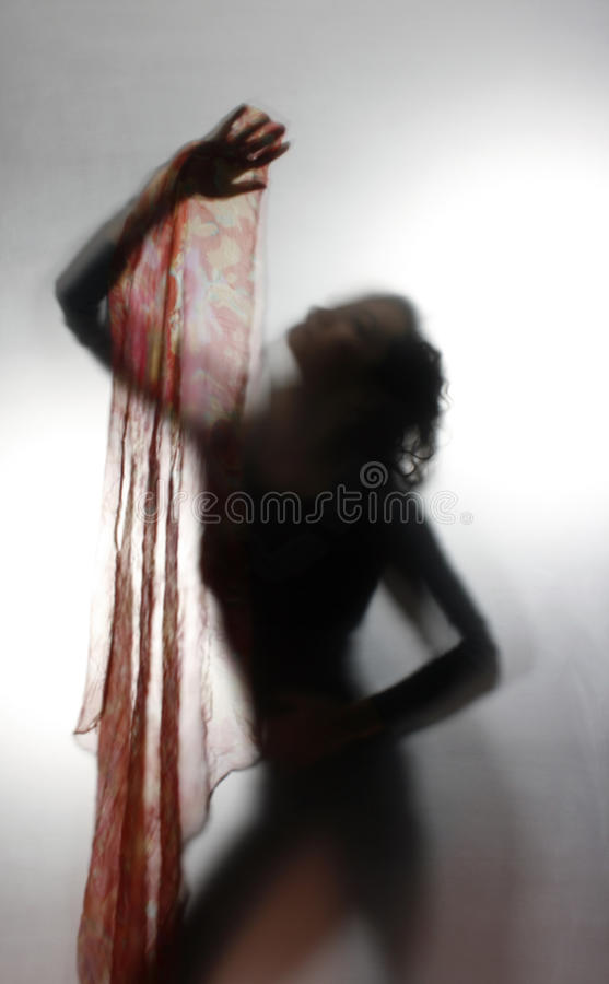 Woman silhouette dancing. In the light royalty free stock images