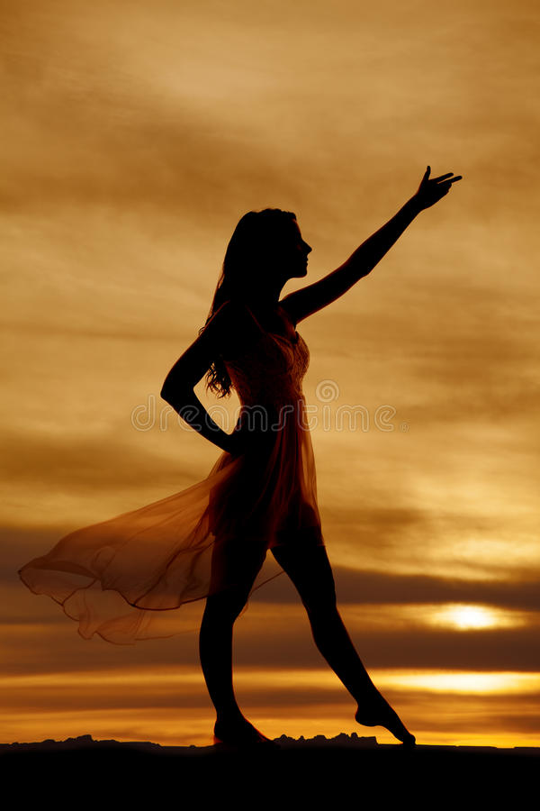 Woman silhouette dress blow hand up side royalty free stock images