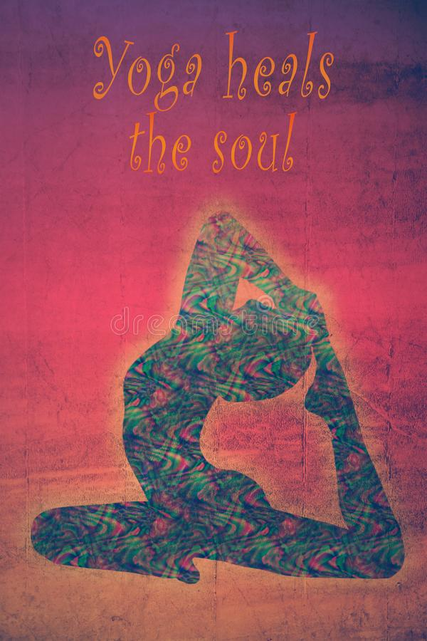 Woman silhouette in king pigeon yoga position with quote yoga heals the soul stock photography