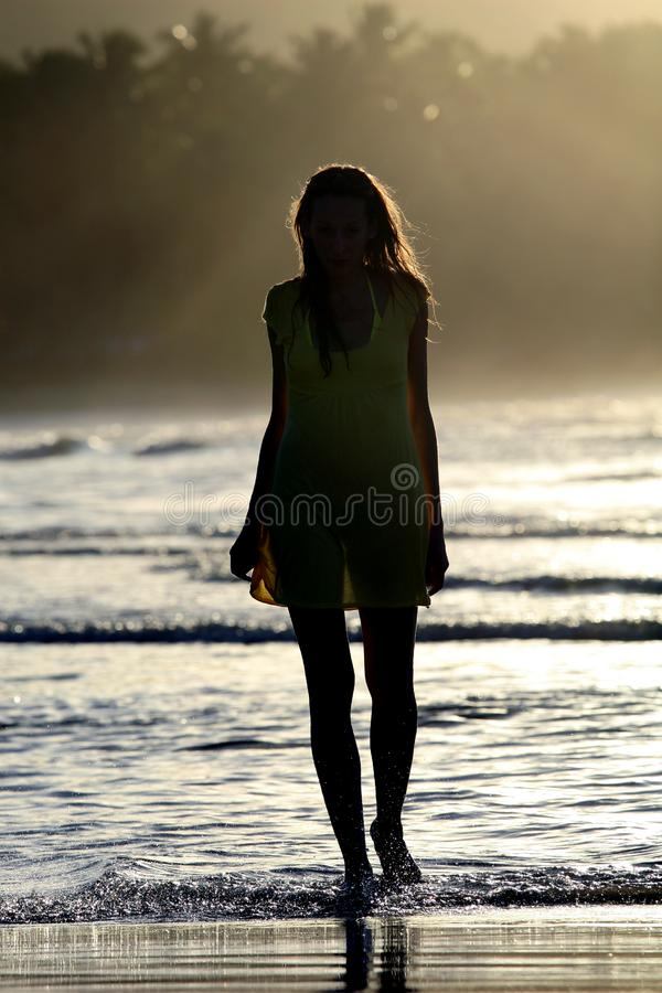 Woman silhouette by sunset royalty free stock image