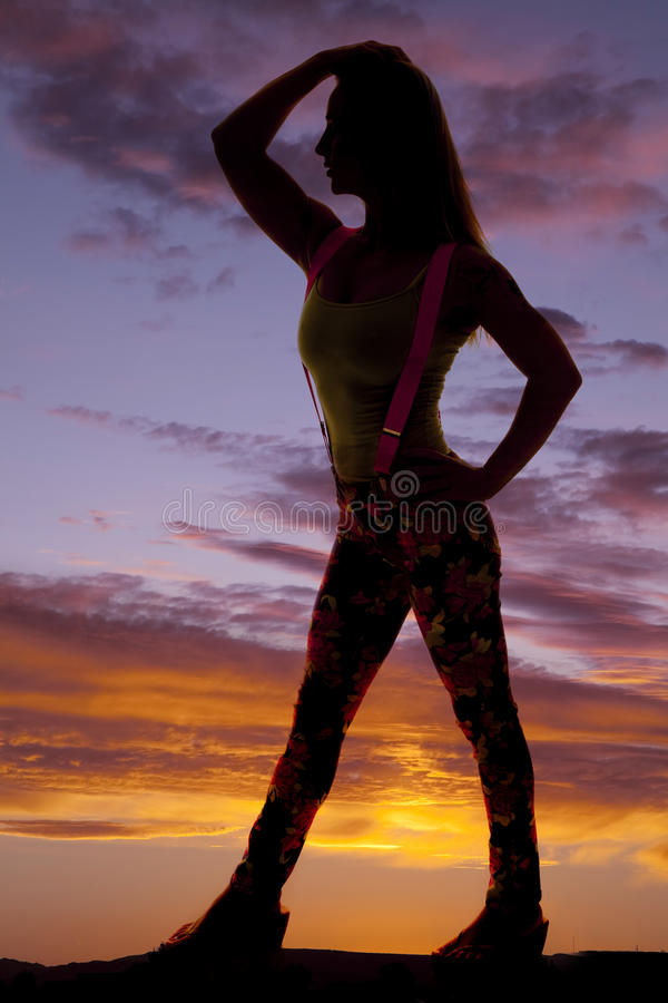 Woman silhouette suspenders side royalty free stock photography