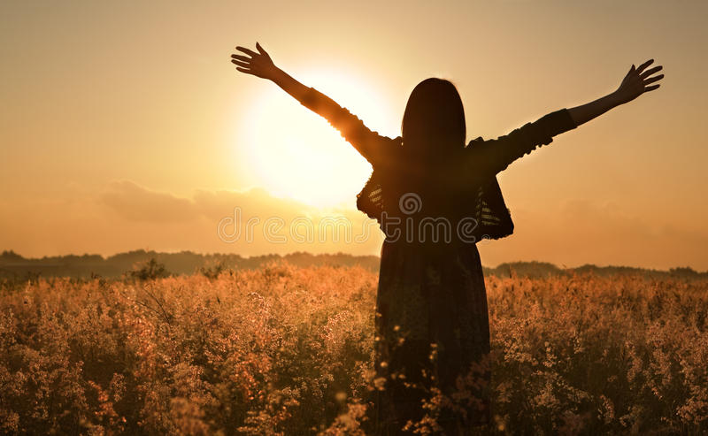 Woman silhouette waiting for summer sun stock image