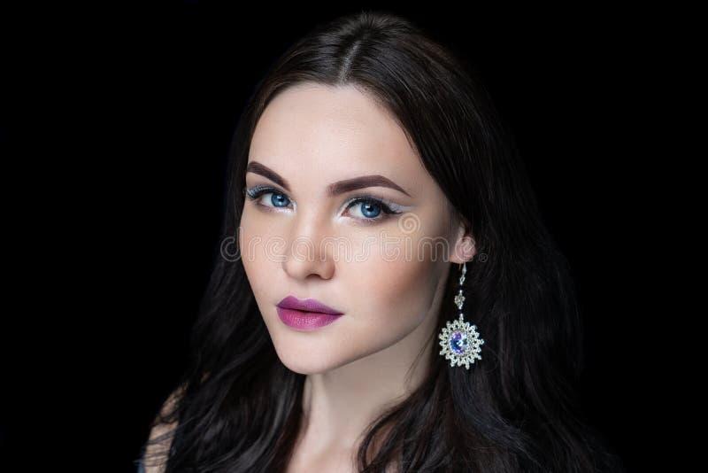 Woman silver massive earrings royalty free stock image