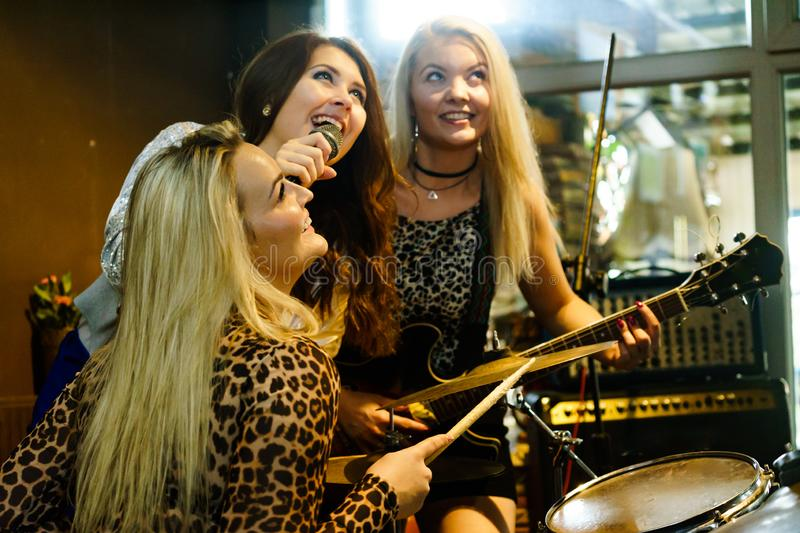 Woman singing, band playing instruments stock photography