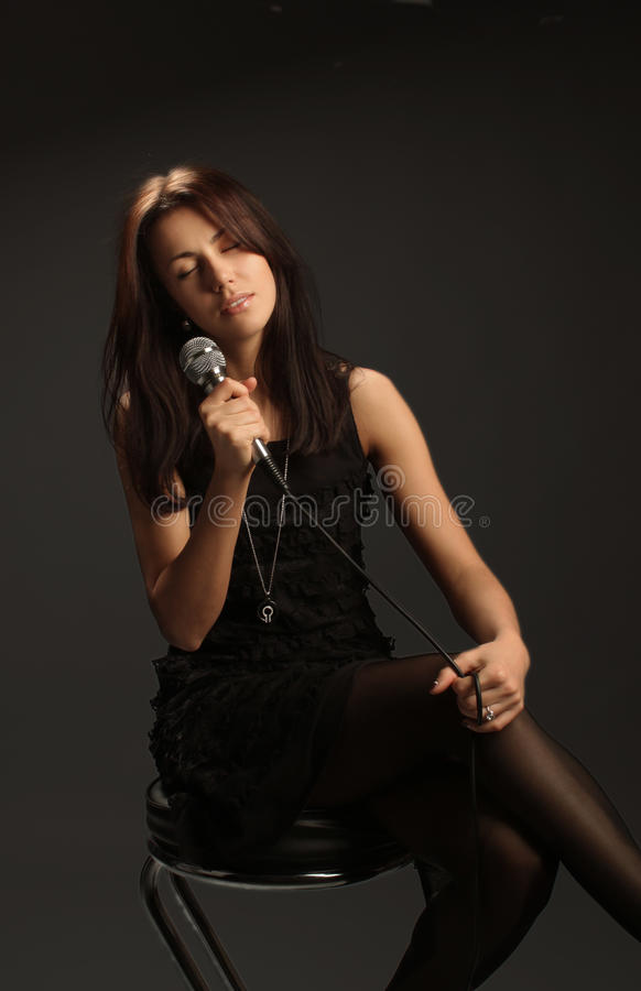 Free Woman Singing Into Microphone Stock Photo - 13144050