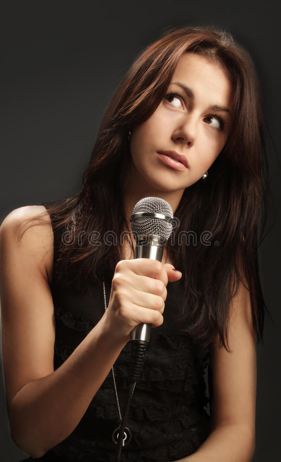 Free Woman Singing Into Microphone Royalty Free Stock Images - 13144099