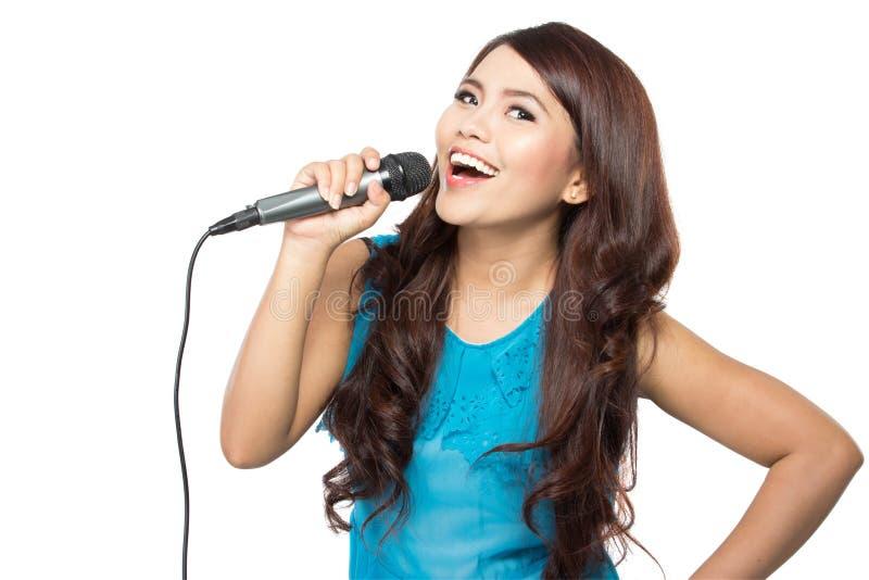 Woman singing karaoke stock photos