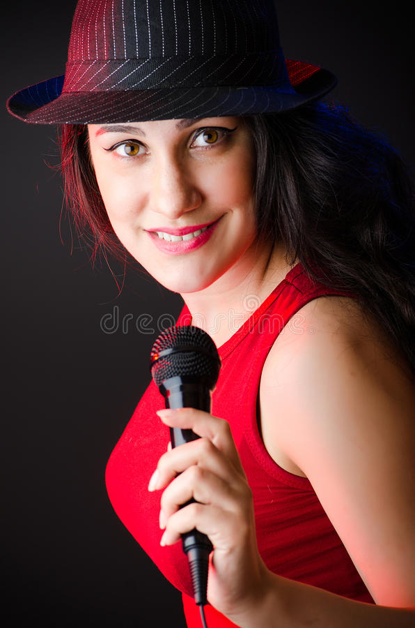 The woman singing in karaoke club royalty free stock photos