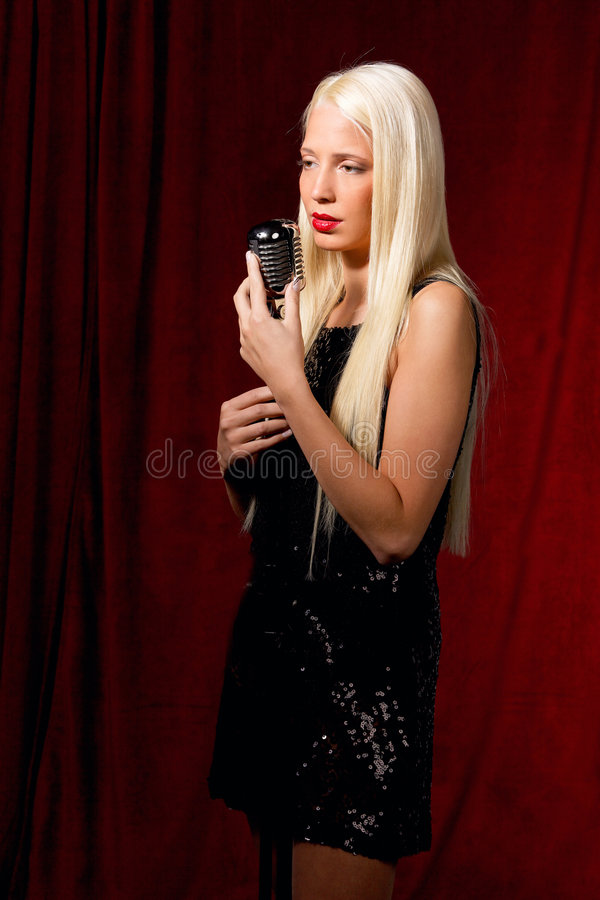 Woman singing with mic stock image