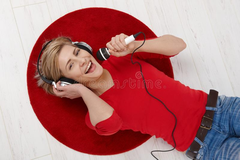Woman singing into microphone royalty free stock photography